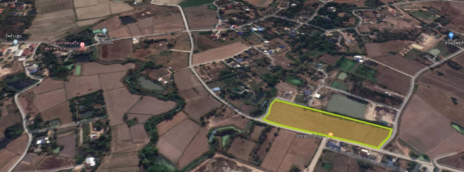 Land for sale 14 rai next to the road.