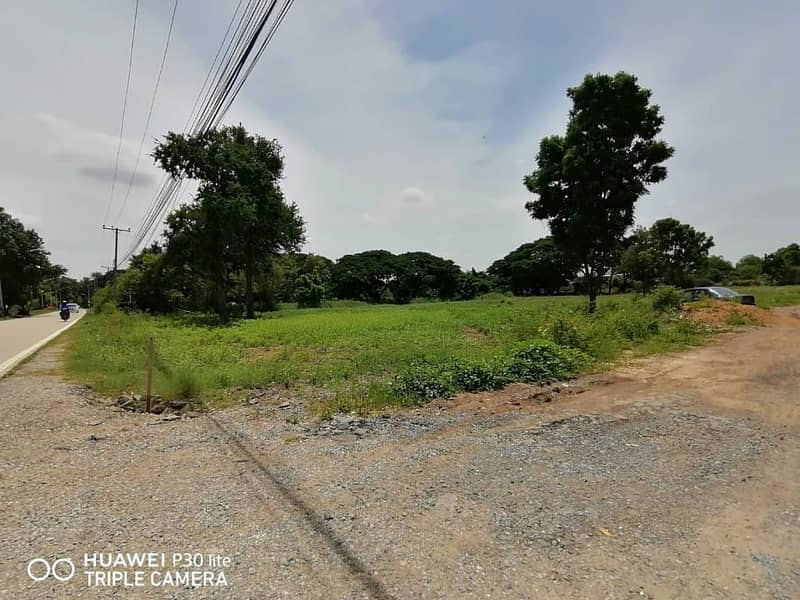 Land for rent on the eastern side of Khlong 6 Road near the housing estate, Khlong Luang District, Pathum Thani Province, near the community, housing development village, school, university, hospital