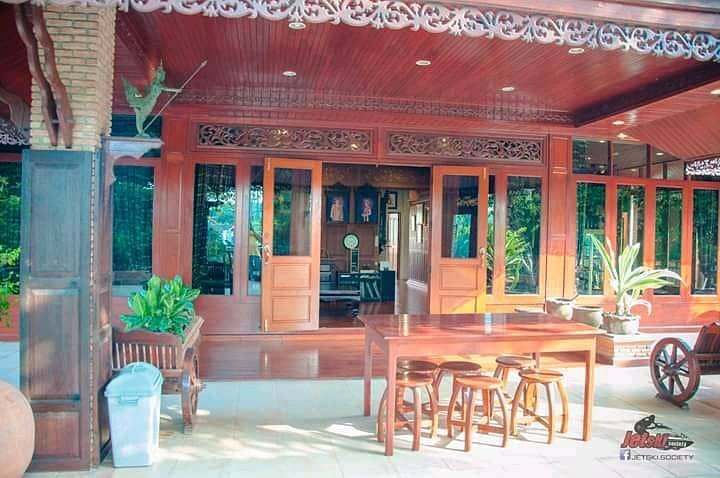 Golden teak house by the water