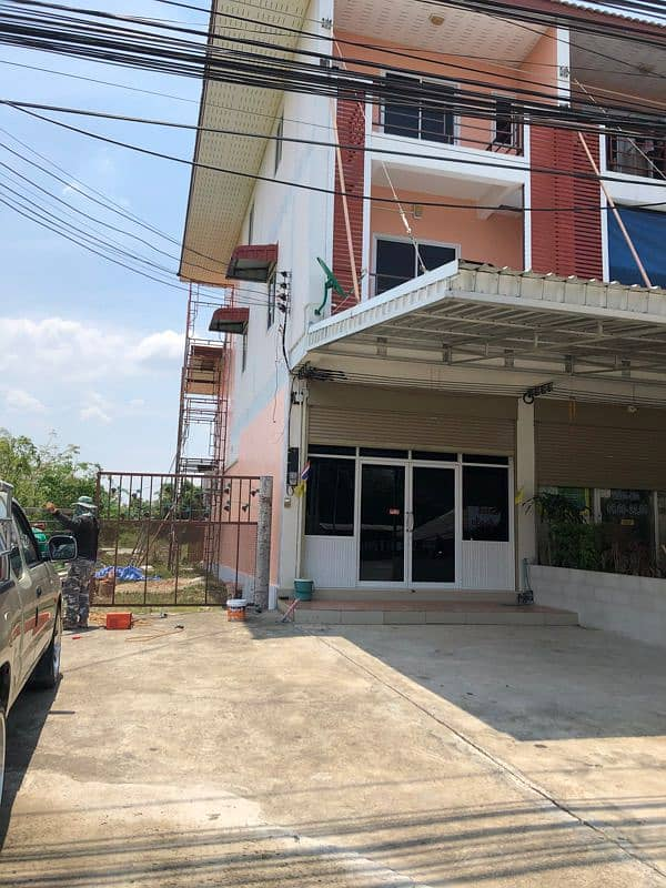 Commercial building for sale on the corner with land